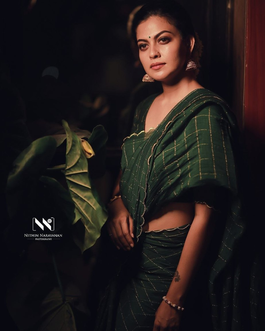 Anusree Nair in bottle green saree by Jugalbandhi-1