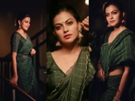 Anusree Nair in bottle green saree by Jugalbandhi-featured
