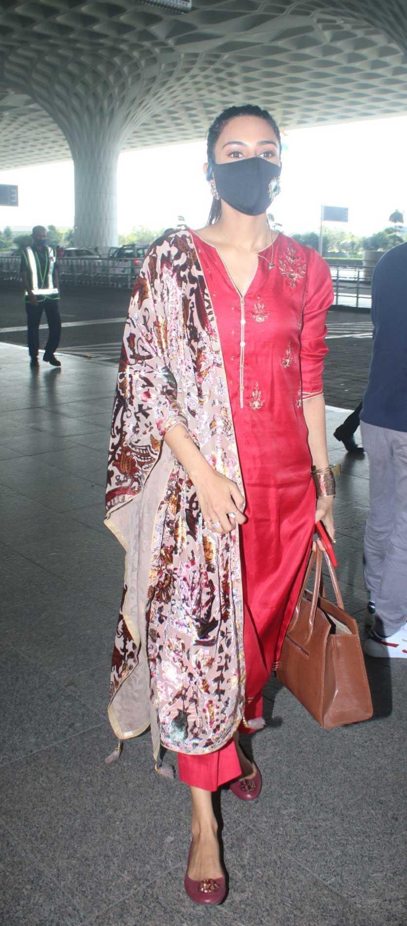 Erica fernandez in red kurta set outside airport departure