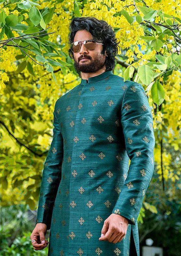 Sudheer Babu in green ethnic wear by raamz for son's dhoti ceremony-1