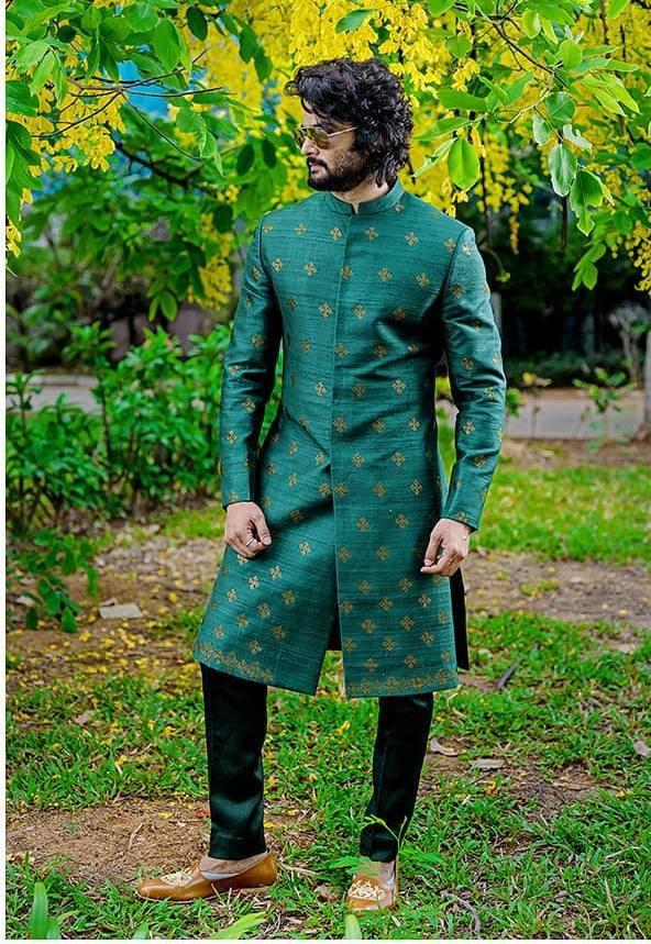 Sudheer Babu in green ethnic wear by raamz for son's dhoti ceremony