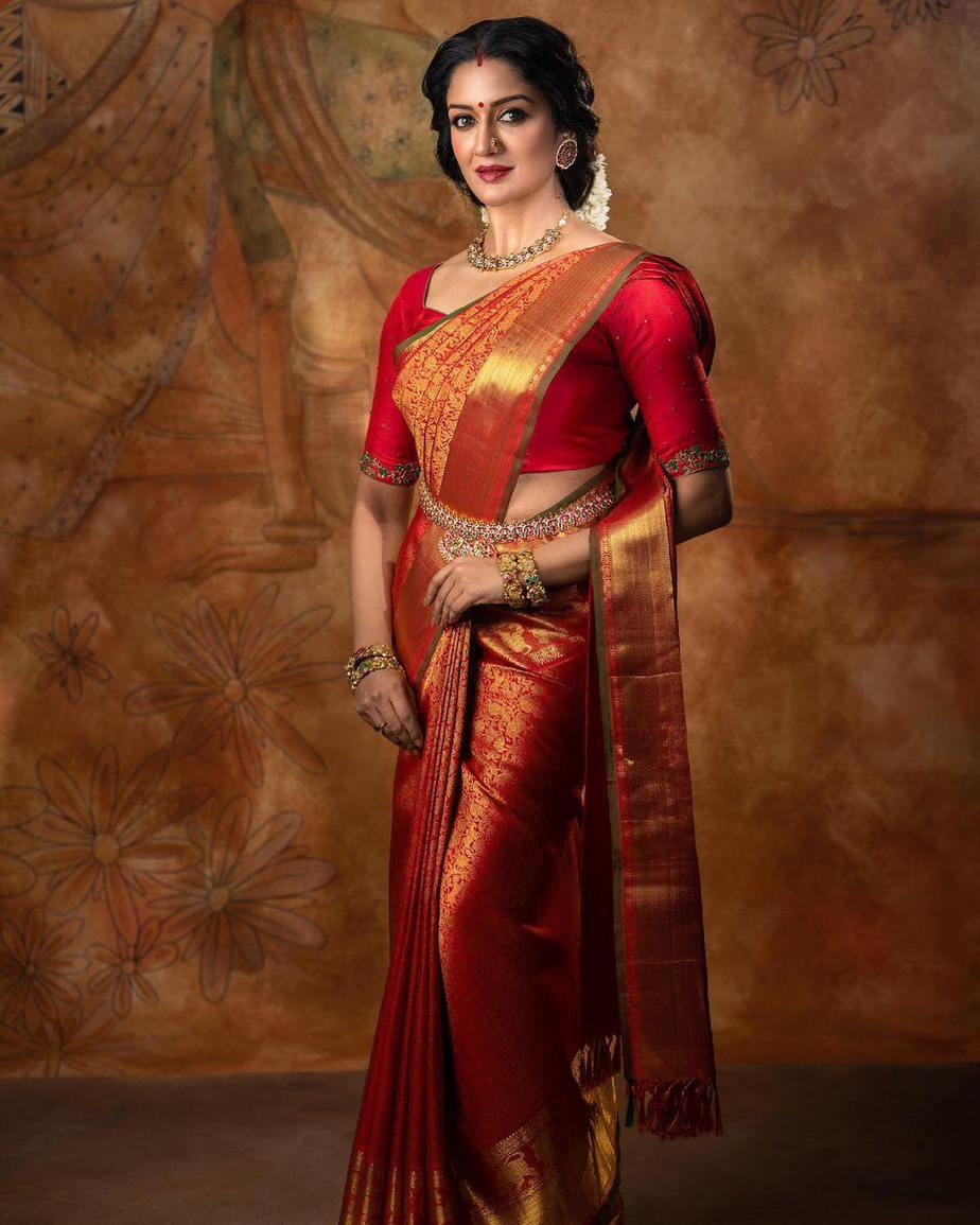 Vimala Raman in red kanchi saree by Anya Boutique