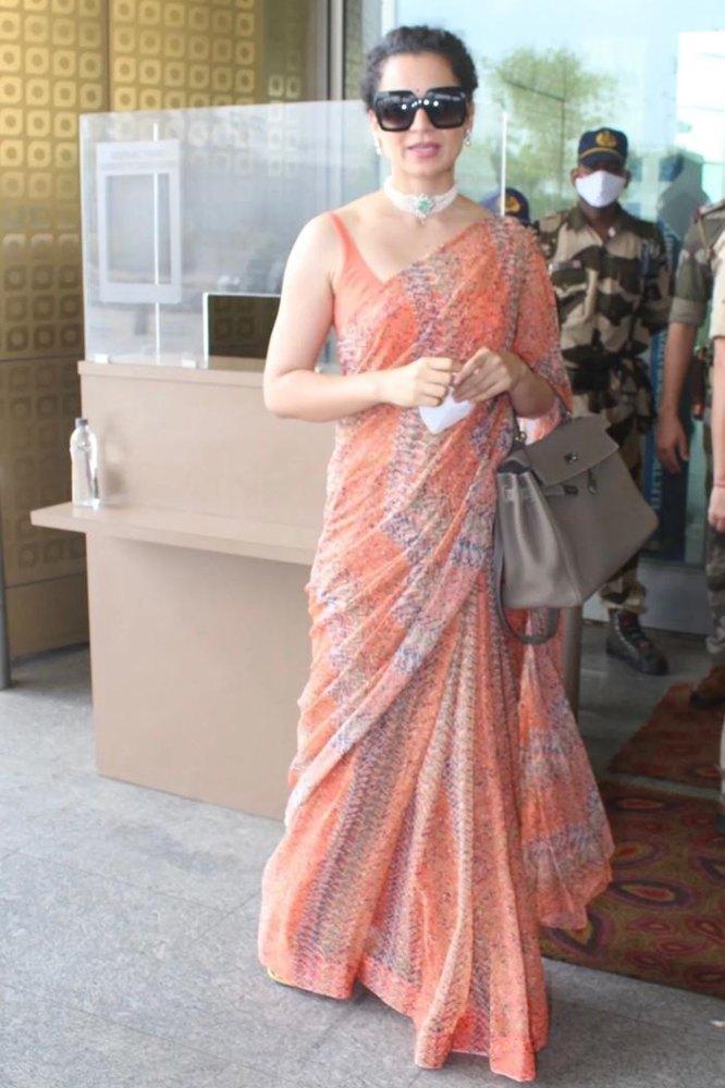 kangana ranaut in a light orange saree at airport