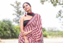 Anasuya bharadwaj in a red saree for jabardasth