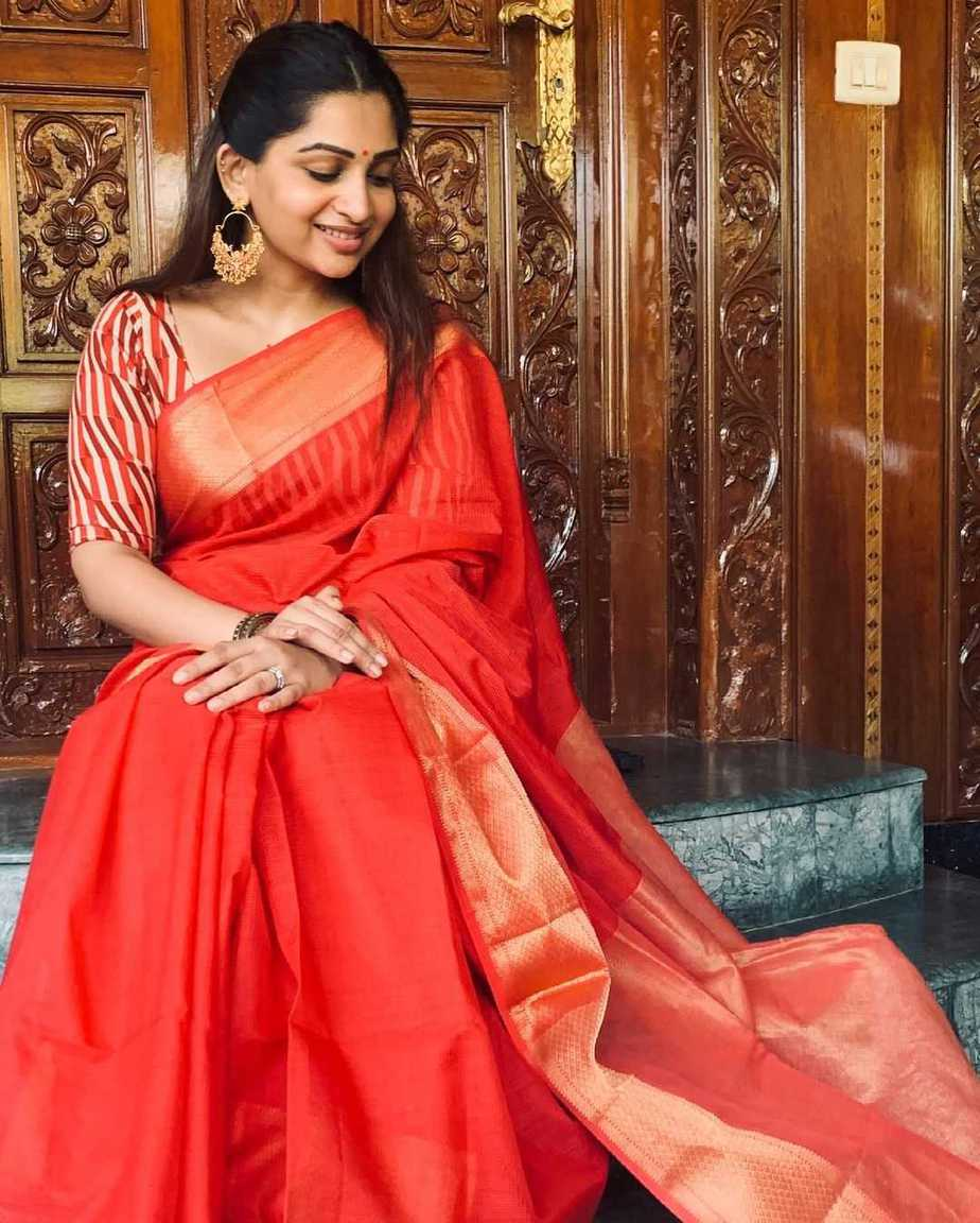 Nakshathra Nagesh in a red saree by Suviha collections