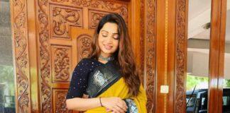 Nakshathra Nagesh in yellow saree by aishwaryam textiles