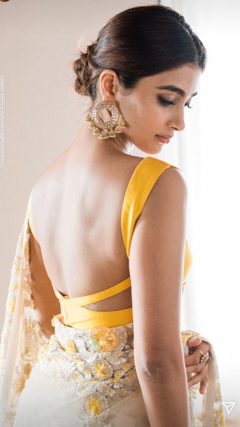 Pooja Hegde in a manish malhotra saree