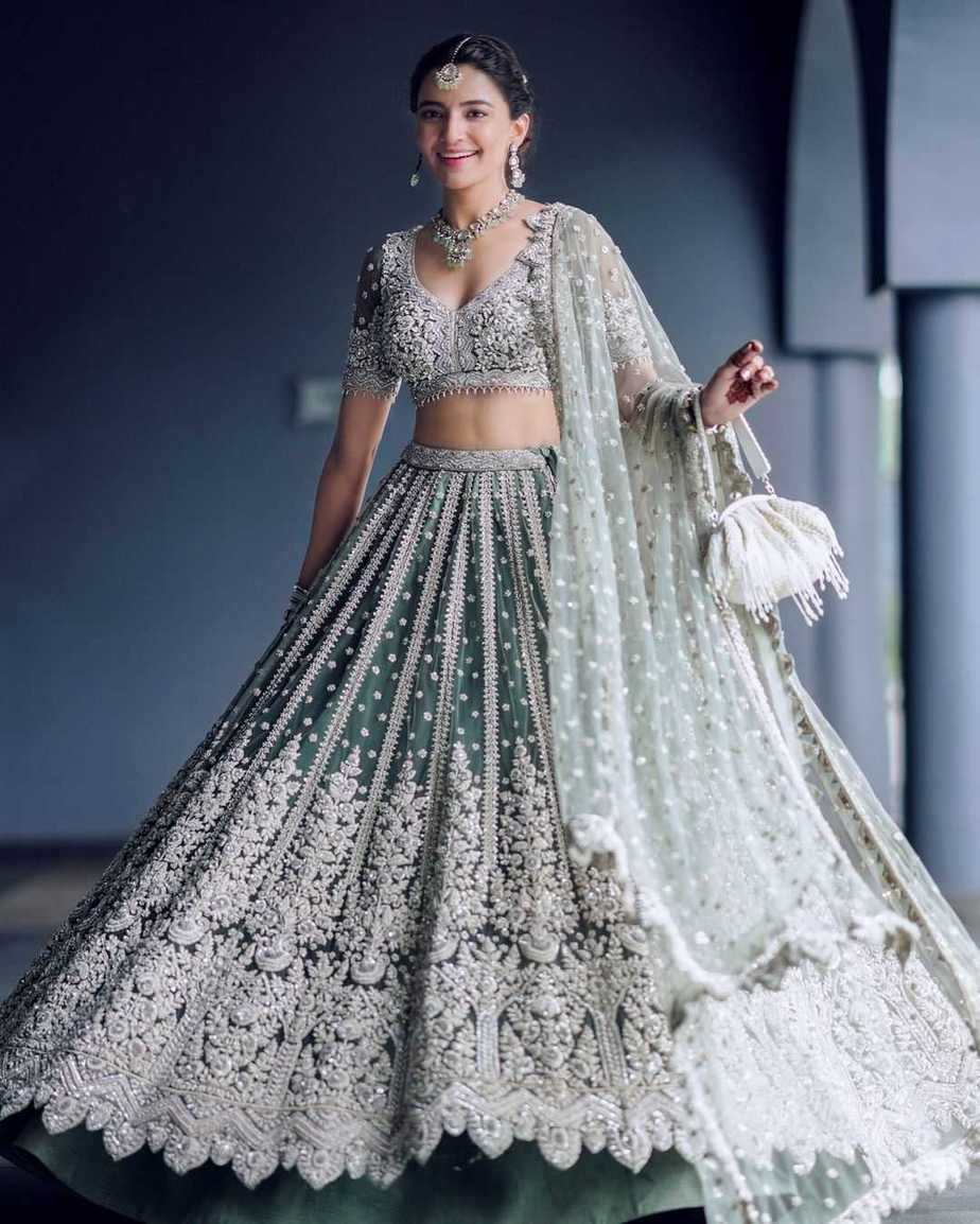 Rukhsar Dhillon in sage green lehnga by Frontier Raas for sister's wedding