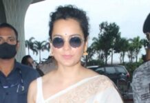Celebrities have started hitting the airport for work and travel. The most commonly spotted one is Kangana Ranaut. Her recent look proclaims her love for ethnic wear. Even on hot summer days, she chooses lightweight Indian outfits. If you don't believe us, then check out her recent look. Kangana Ranaut sported an off-white saree as her airport outfit. Her saree was not plain and featured some light shimmery golden border. It was teamed up with plain white cut sleeved blouse to go with it. For the accessories, she carried a tan handbag to give her look some pop of color. Alongside, to beat the heat, she also wore a round shades and a white mask to adhere the new normal. For the footwear, she wore light colored loafers to go with her outfit. We could also a small black bindi that perfectly went with her outfit color choice. Lastly, she kept her hair tied in a medium bun for that finished and poised look.