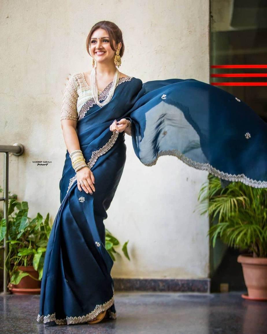 sridevi vijaykumar in a navy blue saree by Preesha for comedy stars