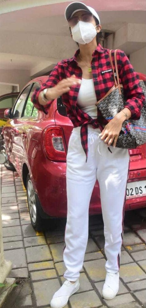 shilpa shetty in red checkered jacket and white shirt