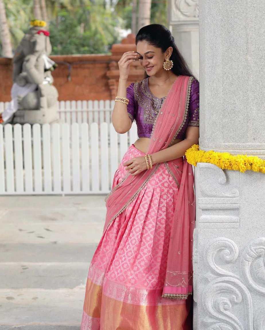 Aishwarya Arjun in pink half saree by Bhargavi kunnam for her family temple opening