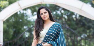 Anasuya Bharadwaj in navy blue saree by Vaasavi couture for Jabardasth