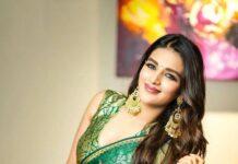 Nidhhi Agerwal in a green raw mango saree