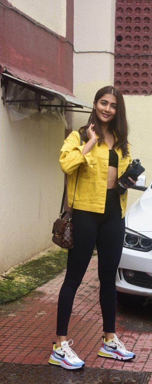 Pooja Hegde in casual yellow denim jacket and black track pants at Bandra-4