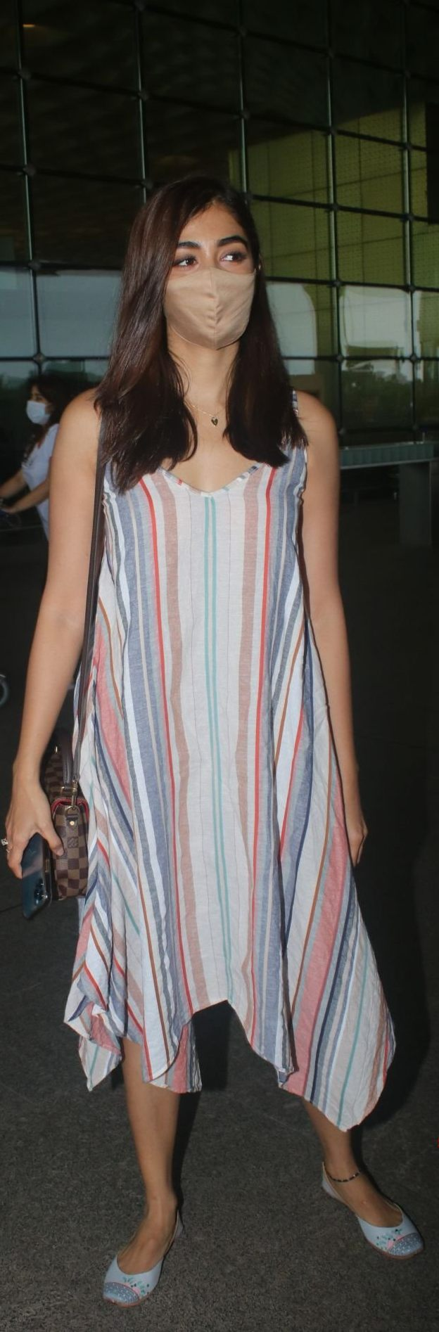 Pooja hegde in a striped dress at the airport