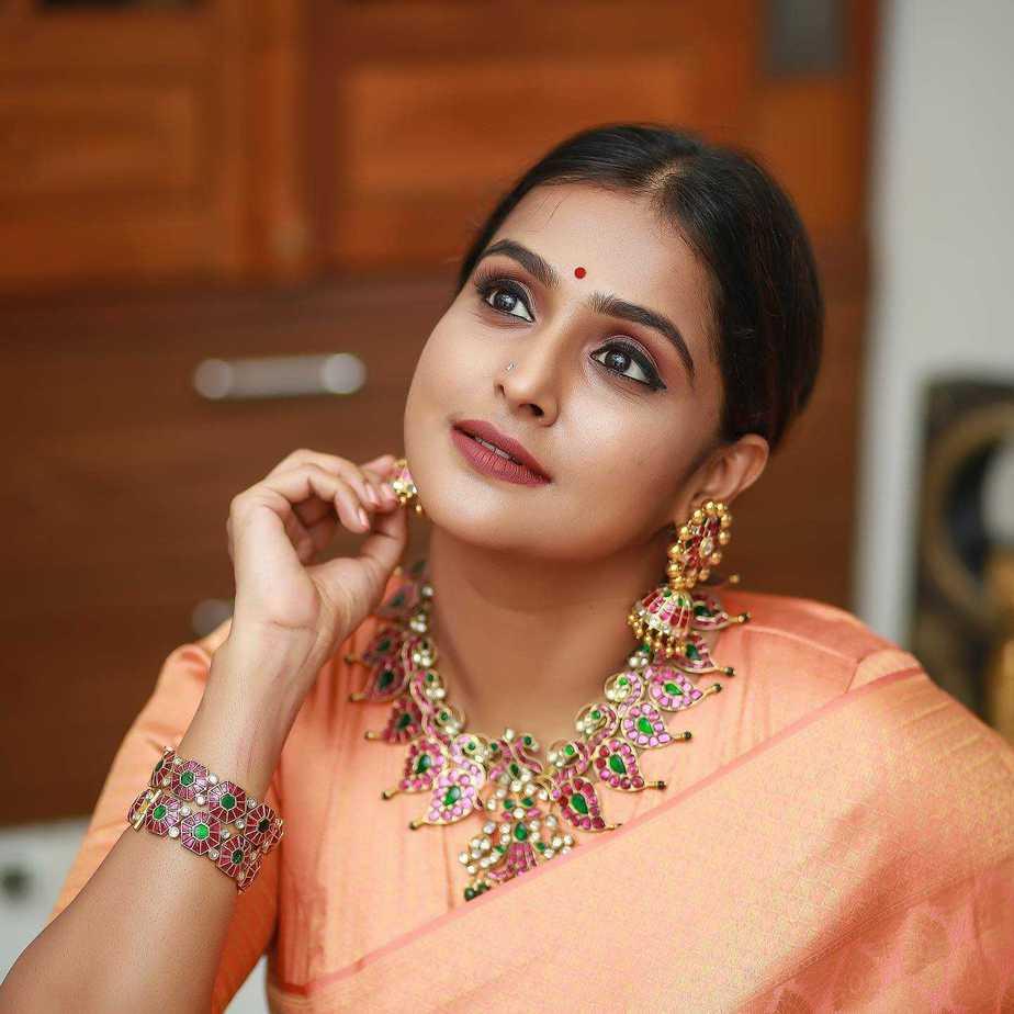 Ramya Nambessan in peach pattu saree by Devraagh-featured