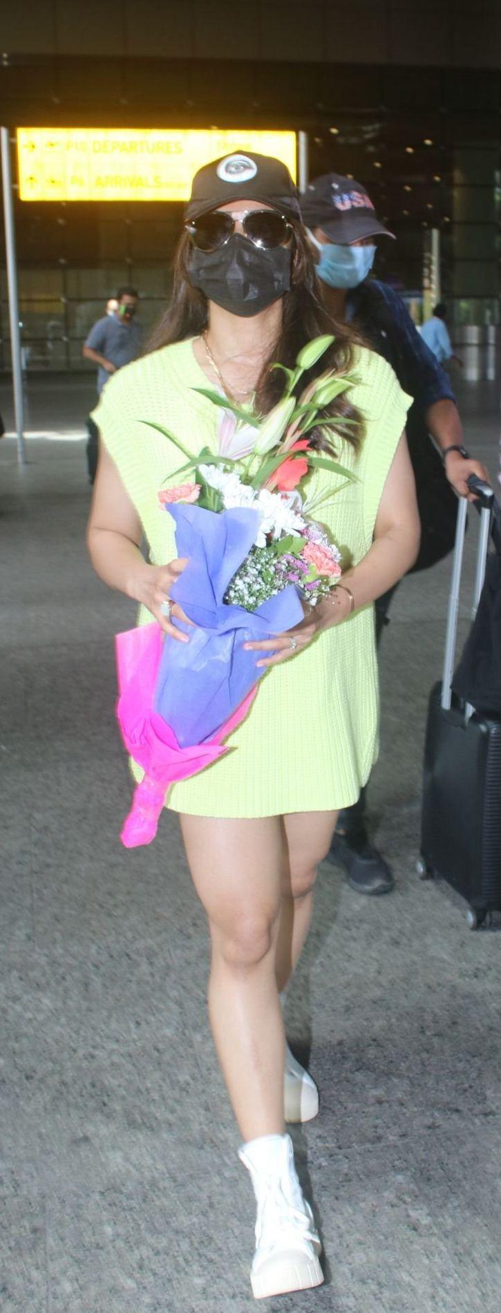 Rashmika Mandanna in a light yellow sweater dress at the airport-1