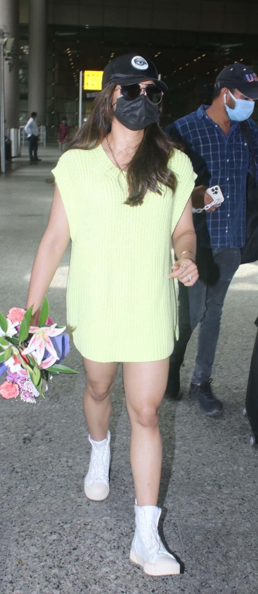 Rashmika Mandanna in a light yellow sweater dress at the airport-2