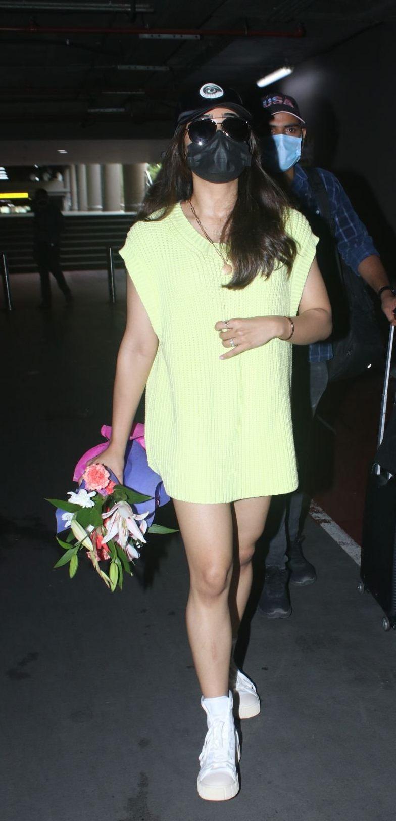 Rashmika Mandanna in a light yellow sweater dress at the airport-3