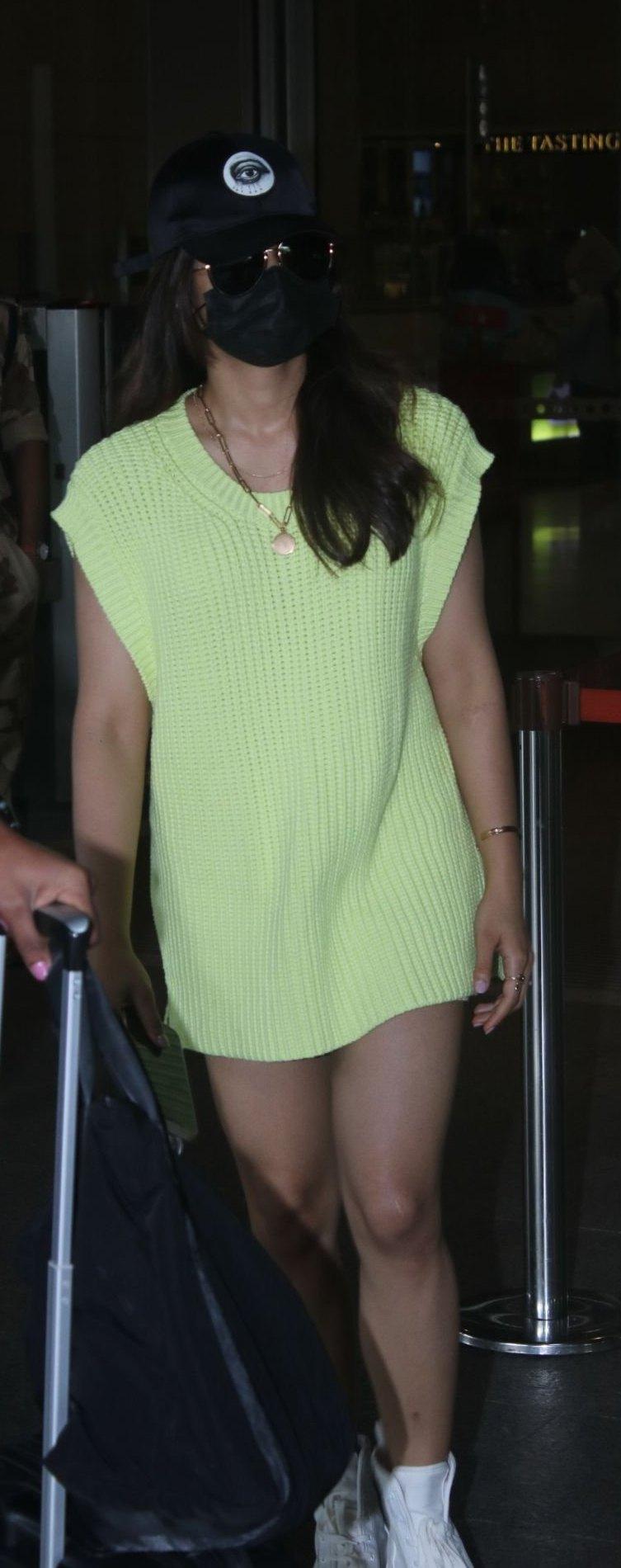 Rashmika Mandanna in a light yellow sweater dress at the airport