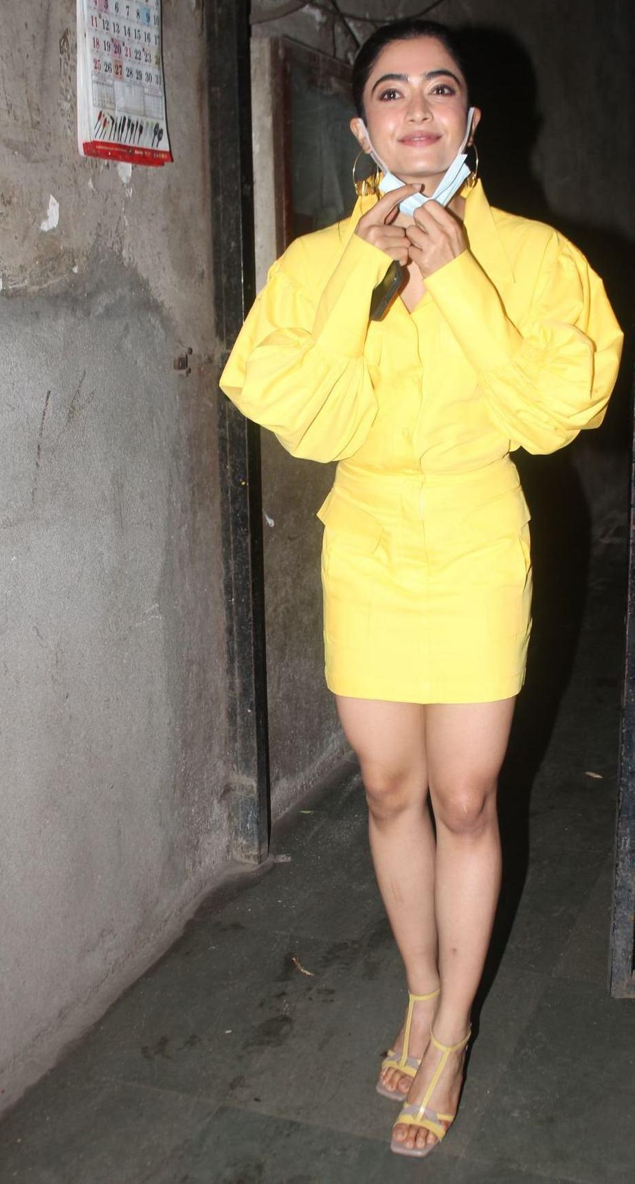 Rashmika Mandanna in yellow shirt mini skirt at monochrome studios-1