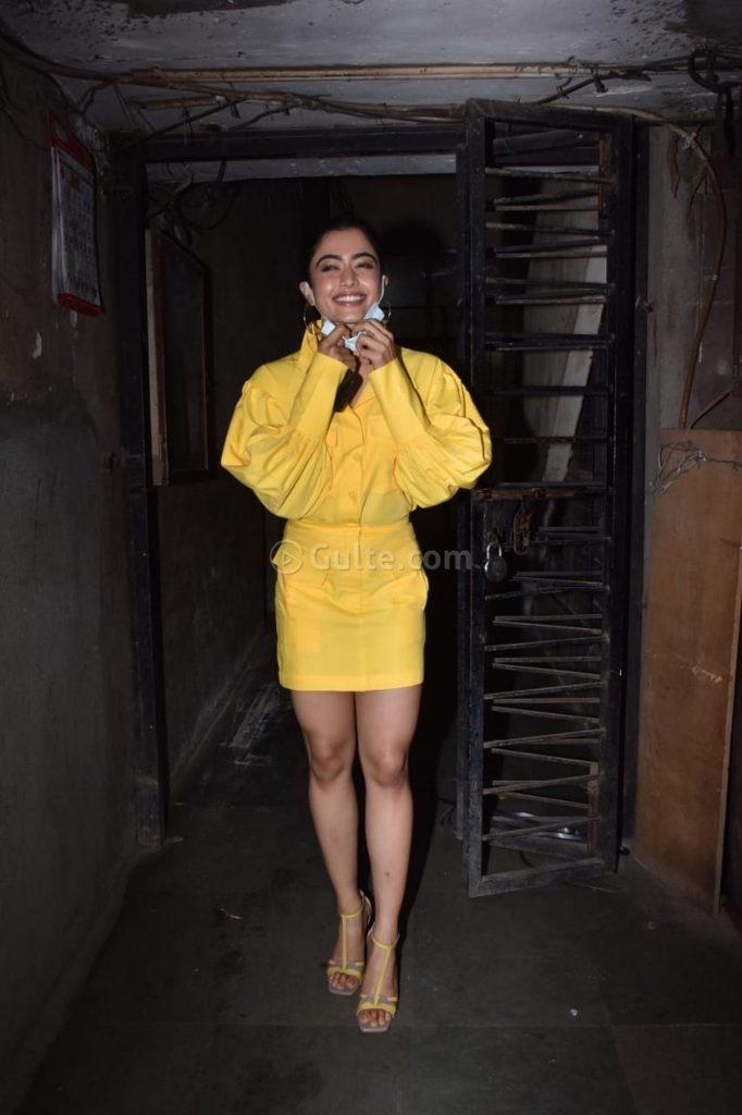 Rashmika Mandanna in yellow shirt mini skirt at monochrome studios-2