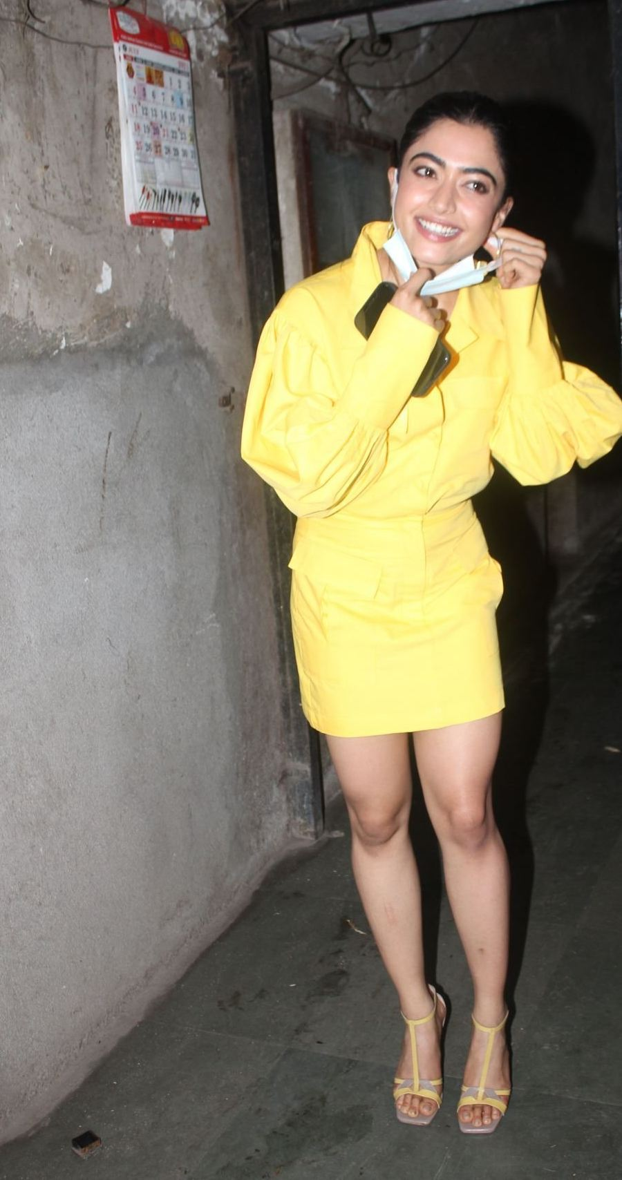 Rashmika Mandanna in yellow shirt mini skirt at monochrome studios-3