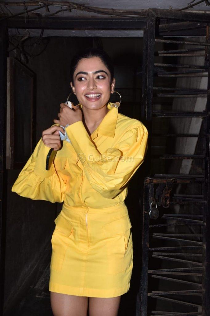 Rashmika Mandanna in yellow shirt mini skirt at monochrome studios