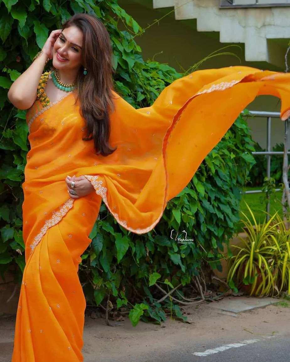 Sridevi Vijaykumar in a orange saree by brand mandir for Comedy stars