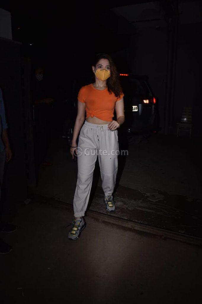 Tamannaah Bhatia in an orange knotted tee and beige pants-1