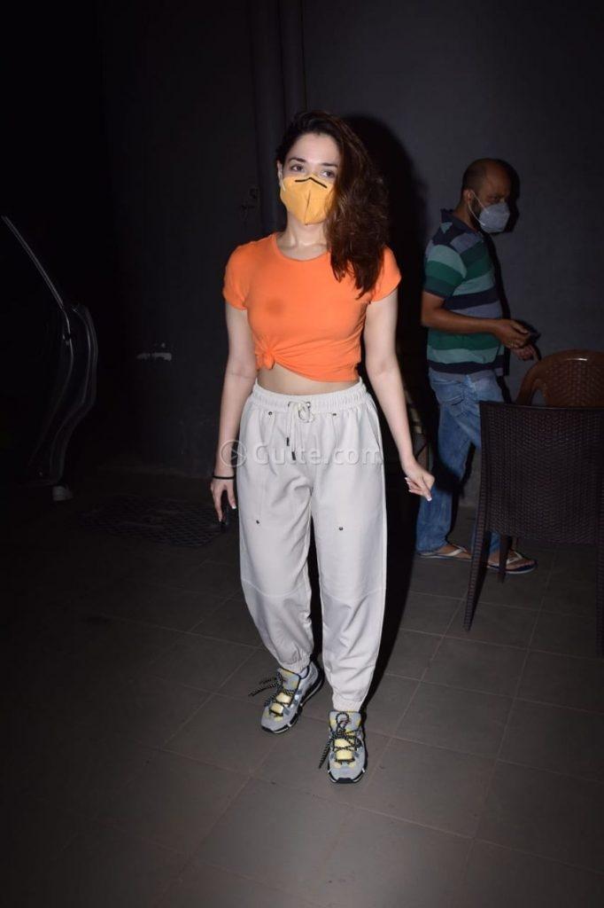 Tamannaah Bhatia in an orange knotted tee and beige pants-2