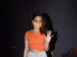 Tamannaah Bhatia in an orange knotted tee and beige pants