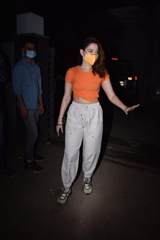 Tamannaah Bhatia in an orange knotted tee and beige pants-3