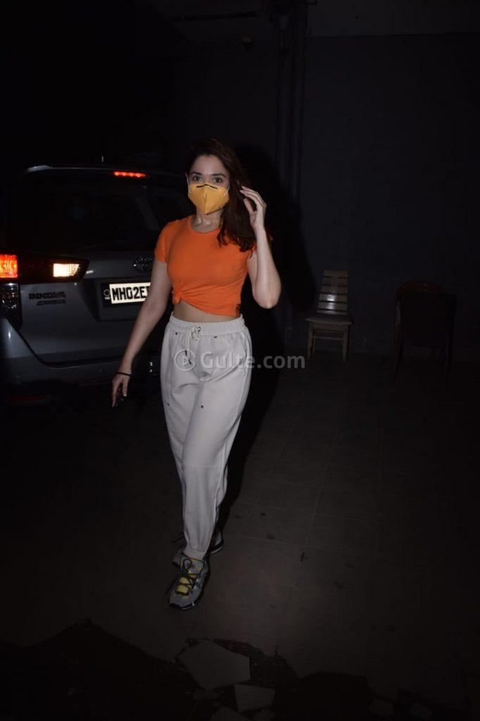 Tamannaah Bhatia in an orange knotted tee and beige pants-4
