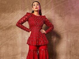 karishma in red peplum style suit from ritika