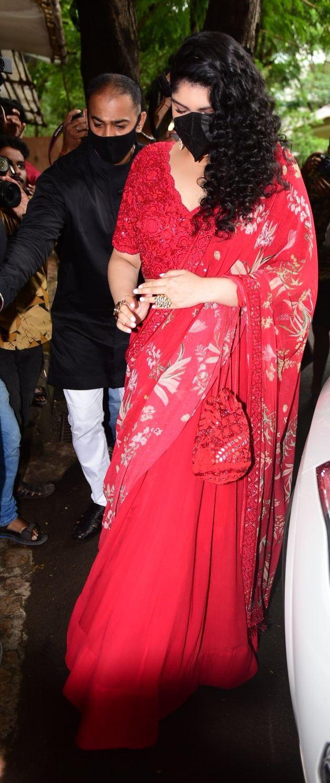 Anshula Kapoor in a red lehenga at rhea kapoor's wedding