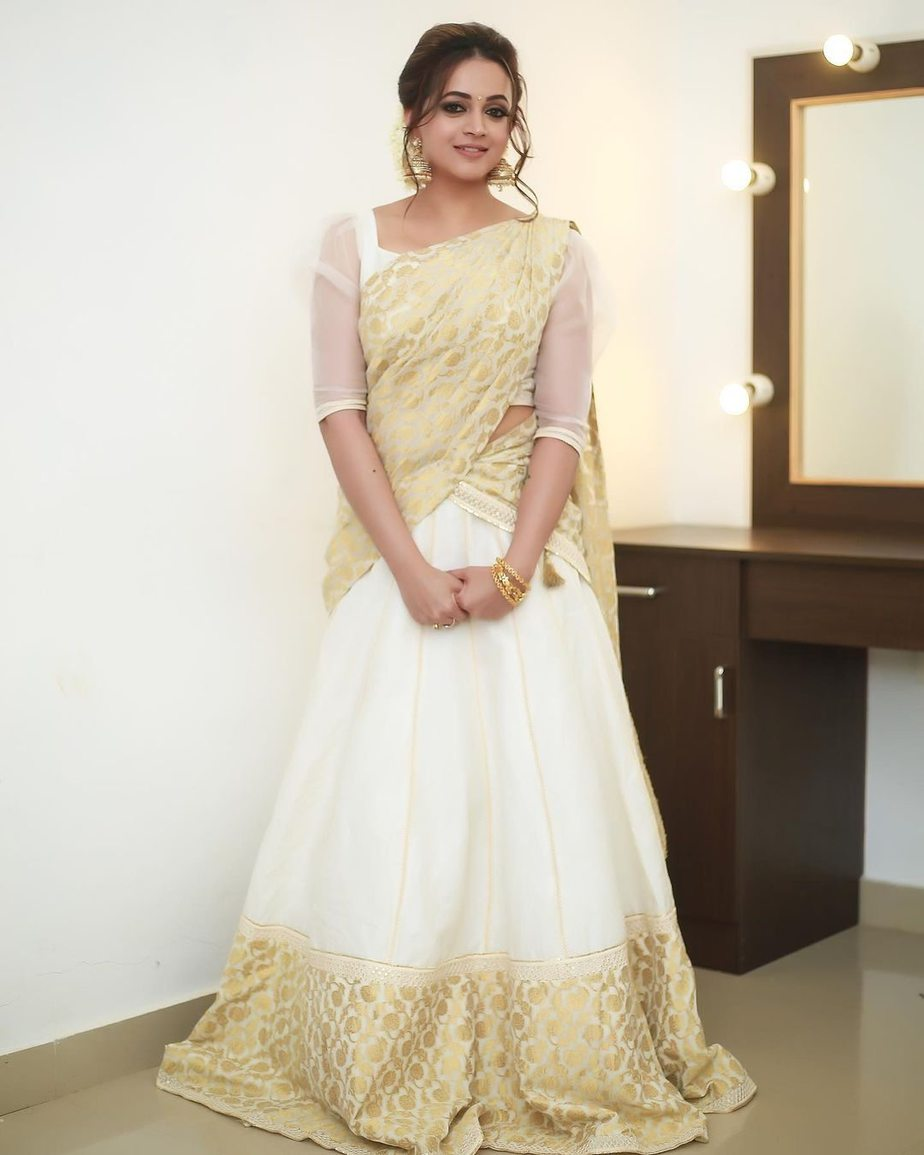 Bhavana Menon in a kasavu half saree by label M-2