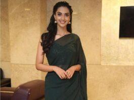 Meenakshi chaudhary in a green saree by Miraya forIchata Vahanamulu Niluparadu pre release event