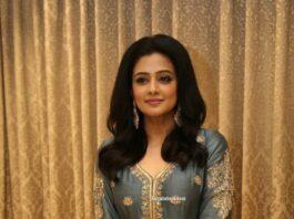 Priya Mani Raj in a grey front slit anarkali for Narappa success meet
