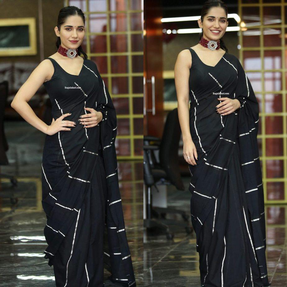 Ruhani sharma in black rouka saree for Nootokka Jillala Andagaadu interview-1