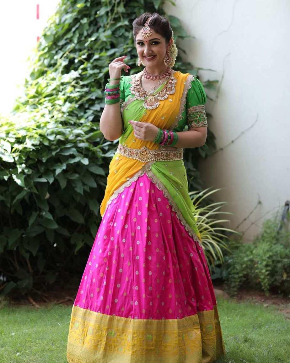 Sridevi Vijaykumar in a parrot green half saree by varahi art studio for comedy stars