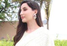 nora fatehi in off-white suit