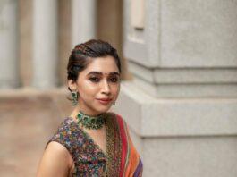Aarti Ravi in a multi coloured Sabyasachi saree for a wedding-2