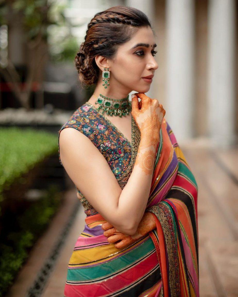 Aarti Ravi in a multi coloured Sabyasachi saree for a wedding-3