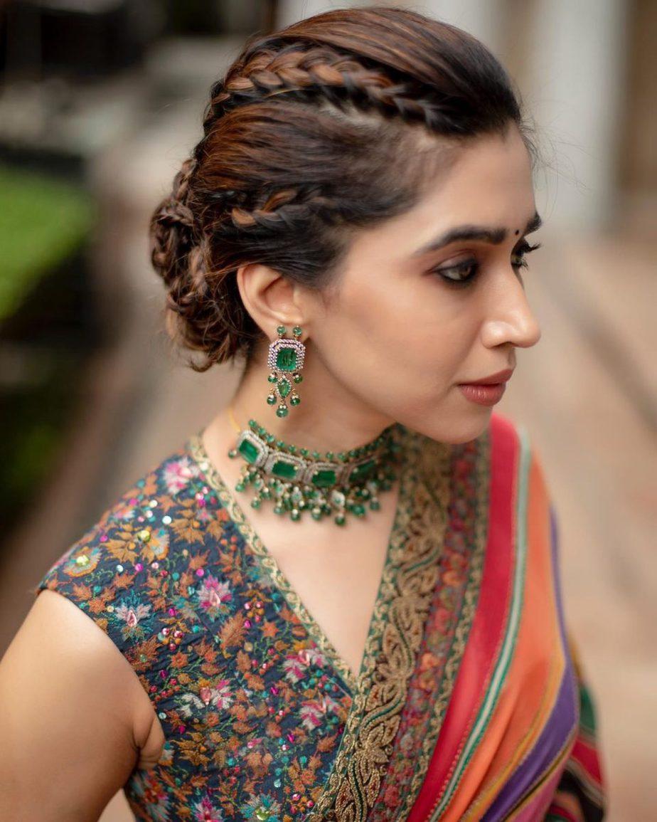 Aarti Ravi in a multi coloured Sabyasachi saree for a wedding