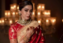 Aarti Ravi in a red saree by Sabyasachi