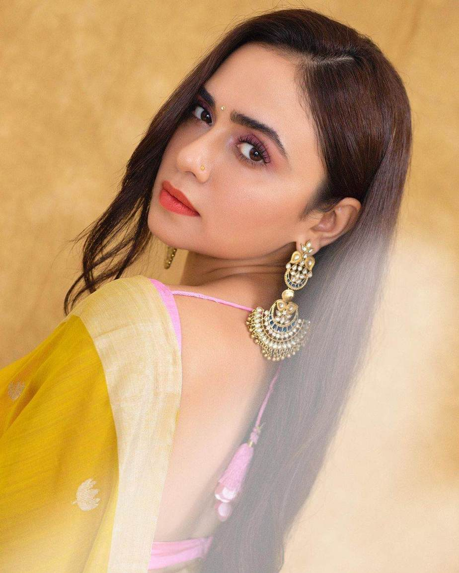 Amruta Khanvilkar in a lime yellow mint and oranges saree for an ott launch-2