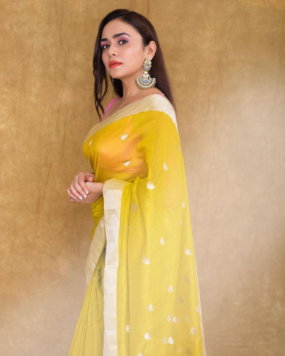 Amruta Khanvilkar in a lime yellow mint and oranges saree for an ott launch-3