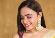 Amruta Khanvilkar in a lime yellow mint and oranges saree for an ott launch-4